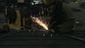Blacksmith or welder,with its grinding smooths steel and iron.The grinding wheel contact with the iron causes sparks