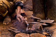Blacksmith at Work. An old blacksmith working traditionally with little wood and pressured gas Royalty Free Stock Photo