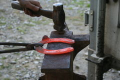 Blacksmith at work. While changing a horseshoe royalty free stock photography