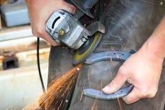 Blacksmith at work. While changing a horseshoe Stock Photo