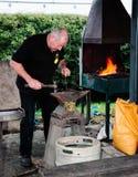 Blacksmith at work on anvil Stock Image