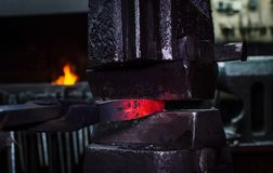Blacksmith at work. Hit with a hammer by a hot metal on the anvil Stock Images