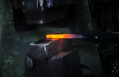 Blacksmith at work. Hit with a hammer by a hot metal on the anvil Stock Photography