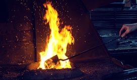Blacksmith at work. Hit with a hammer by a hot metal on the anvil Royalty Free Stock Photography