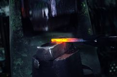 Blacksmith at work. Hit with a hammer by a hot metal on the anvil Stock Image