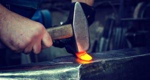 Blacksmith at work stock photos