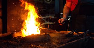 Blacksmith at work. Hit with a hammer by a hot metal on the anvil Royalty Free Stock Images