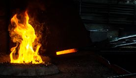 Blacksmith at work. Hit with a hammer by a hot metal on the anvil Royalty Free Stock Image