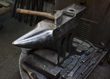 Blacksmith at work. Hit with a hammer by a hot metal on the anvil Royalty Free Stock Photo