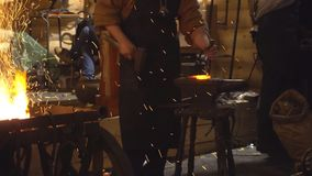 Blacksmith at work in the smithy