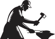 Blacksmith Worker Forging Iron Black and White Woodcut. Black and white illustration of a blacksmith worker forging iron viewed from the side set on isolated Royalty Free Stock Image