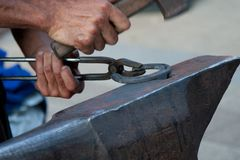 Blacksmith working Stock Images