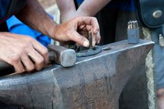 Blacksmith working Stock Photos