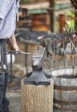 Blacksmith working with anvil Royalty Free Stock Photos