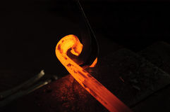 Blacksmith working on decorative handrail Royalty Free Stock Photos