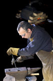 Blacksmith working on decorative handrail Stock Photo