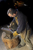 Blacksmith working on decorative handrail Stock Image
