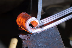 Blacksmith working on decorative handrail Stock Photos