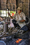 Blacksmith working in his smithy Stock Image