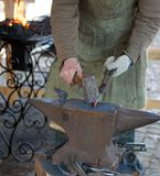 Blacksmith. Working on manufacturing decorative element for gates Stock Photography
