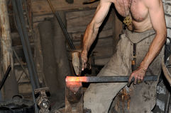 Blacksmith working on metal on anvil at forge high speed Stock Photography