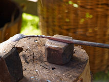Blacksmith working on metal on an anvil Royalty Free Stock Photos