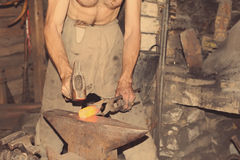 Blacksmith working metal with hammer Royalty Free Stock Photos