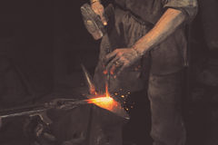 Blacksmith working metal with hammer Royalty Free Stock Photo