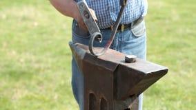 Blacksmith working stock video