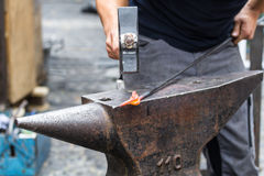 Blacksmith working. Traditional style blacksmith at work. Hammer hands and iron Stock Photo