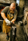 Blacksmith working in workshop Royalty Free Stock Photography
