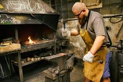 Blacksmith working in workshop Royalty Free Stock Photos