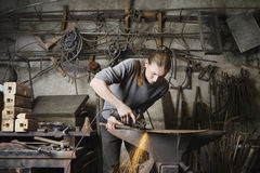 Blacksmith Working In Workshop Royalty Free Stock Photos