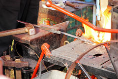 Blacksmith workshop with anvil and fire. Royalty Free Stock Images