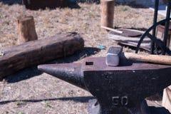 Blacksmith workshop at a medieval craft festival. Forging tools anvil and hammer in a workshop blacksmith Stock Images