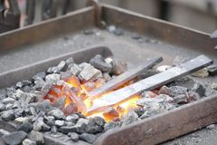 Blacksmith wotk with hammer and hot iron Royalty Free Stock Photos