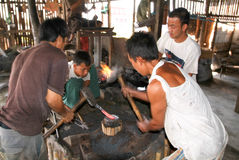 Blacksmiths during the beating of iron at lake Inle stock photography