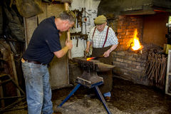 Blacksmiths with elderly father Stock Photo