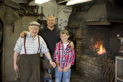 Blacksmiths three generations Stock Images