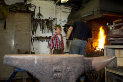 Blacksmiths with young son Royalty Free Stock Photos