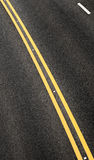 Blacktop with double yellow line divider Royalty Free Stock Photo