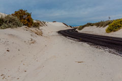 Blacktop Road Winding Through the Amazing Surreal White Sands of New Mexico Stock Photos