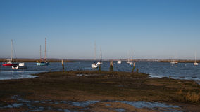 Blackwater Boats. Small boats basking in the winter sunlight on the River Blackwater estuary at Bradwell, Essex, England, UK Royalty Free Stock Image