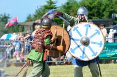 Blackwater Country Fare MALDON ESSEX UK 22 June 2014:  Two Vikings fighting. With sword and shields Royalty Free Stock Photo