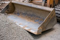 The blade of a bulldozer raking gravel royalty free stock photos
