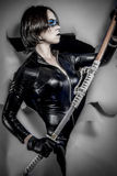 Blade, Girl with katana sword. dressed in black latex, comic sty Stock Photography