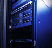 Blade server blur blue toning light fantastic. Equipment mainframe in the data center closeup raid array of hard disk drives Stock Images