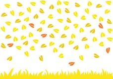 Bladeren die op geel gras regenen Royalty-vrije Stock Afbeeldingen