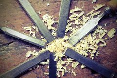 Blades chisels and sawdust chippings. Steel blades chisels and sawdust chippings in Workbench royalty free stock photos