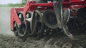 Blades cultivator and seeder sowing machine working on agricultural field